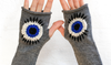 "Why Are People Wearing ""Evil Eye"" Gloves At March For Our Lives? They're Powerful"