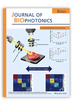 In vivo non-contact measurement of human iris elasticity by optical coherence elastography